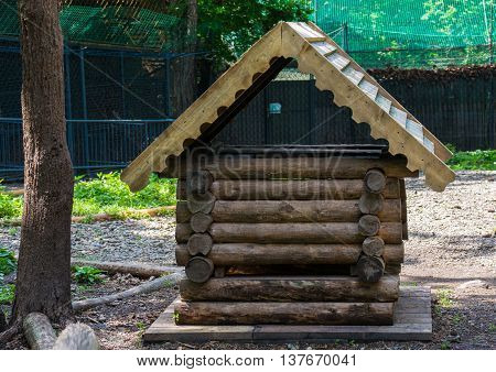 Small wooden house for animals in the aviary reserve
