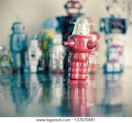 littel red robot toy on wooden floor