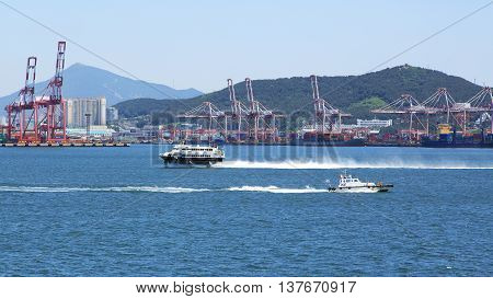 Busan South Korea - Jun 2 2016: Busan a kind on port with a pilotage boat and the ferry hydrofoil.