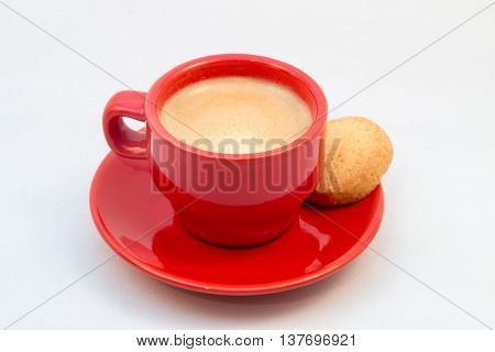 Red Coffee Cup And Saucer With Coffee And Biscuit