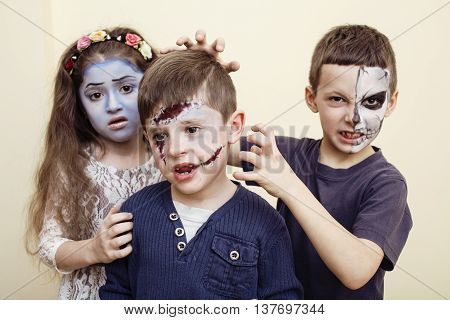 zombie apocalypse kids concept. Birthday party celebration facepaint on children dead bride, scar face,  skeleton together having fun poster
