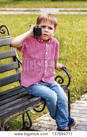 Boy Playing With A Walkie Talkie On A Street In A Playground With A Toy Walkie Talkie Radio, Baby Ou