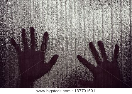 Silhouette of a hand the expression to be imprisoned blur