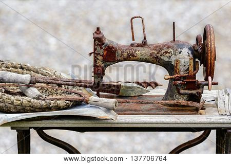 Old sewing machine used in floral arrangement in park of attraction in Zator, Poland. 8 JULY 2016, ZATOR. POLAND.