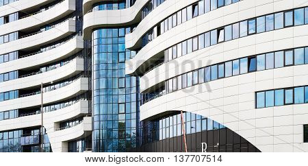 MINSK BELARUS - MAY 03 2016: Renaissance Minsk Hotel - this is the first hotel of the well-known international hotel chain Marriott in Belarus. Close-up of modern architecture. Panoramic shot.