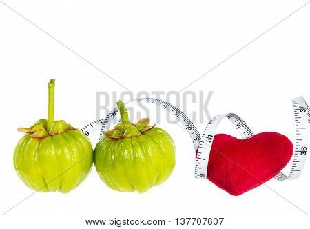 Garcinia Cambogia Fresh Fruit With Red Heart And Measuring Tape, Isolated On White. Fruit For Diet A