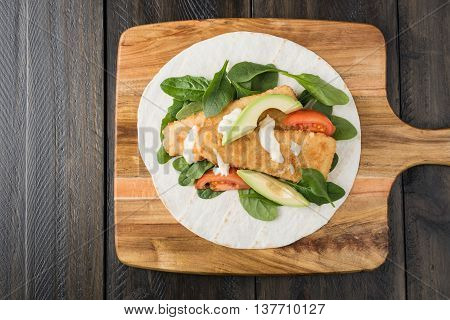 Crumbed Fish Fillet Burrito With Avocado And Tomato