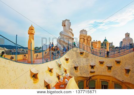Roof With Chimneys And Tourists In Casa Mila Building