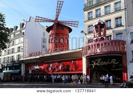 PARIS, FRANCE - MAY 12, 2015: This is world-famous variety Moulin Rouge in Montmartre.
