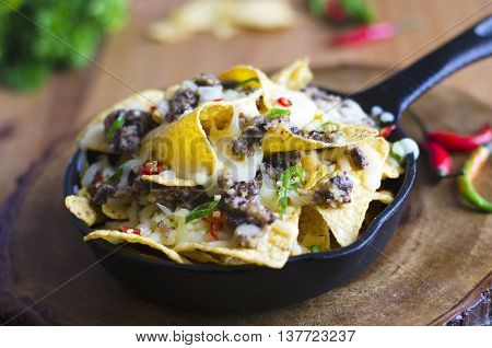 Nachos with haggis melted cheese and chilli peppers