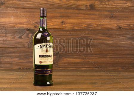 READING MOLDOVA APRIL 8, 2016. One bottle of Jameson Whiskey Triple Distilled 40% 1 Liter on black background. Blended whiskey is imported from Ireland