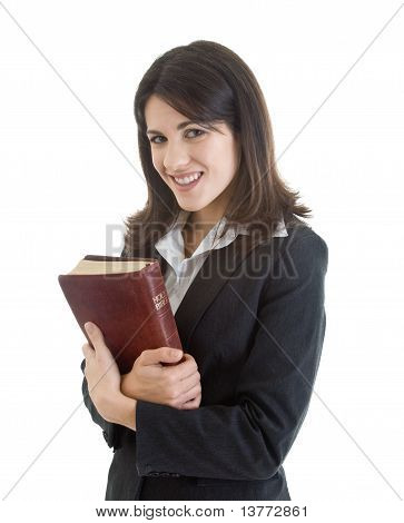 Smiling Woman Holding Bible Closely Isolated White