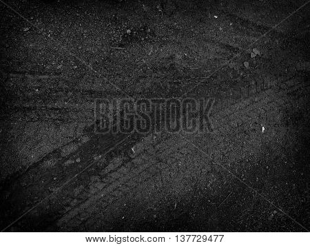 Tire tracks on the road gravel stone background