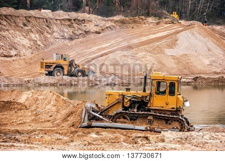 Tractor at a Construction Site and dirt lot.