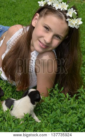 A young girl with a puppy in the nature - a true friend