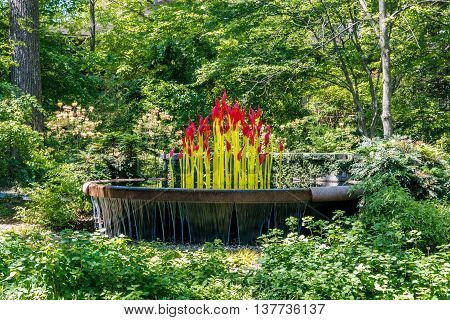 ATLANTA GA USA - APRIL 23 2016: Exhibition of glass artist Chihuly takes place in the Atlanta Botanical Garden in Atlanta Georgia in 2016.