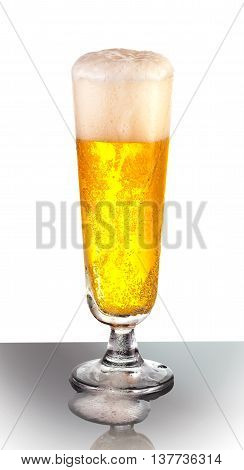 An overflowing glass of refreshing pilsner draft beer