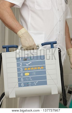 Defibrillator in the hands of doctor, close up
