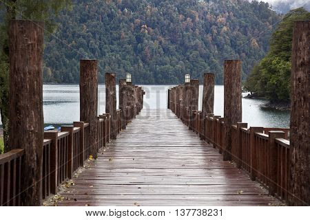 wooden bridge in Puerto Fuy. South Chile
