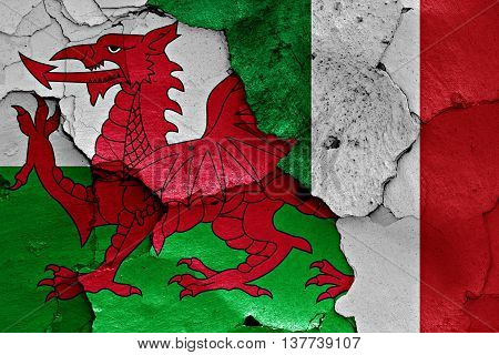 Flags Of Wales And Italy Painted On Cracked Wall