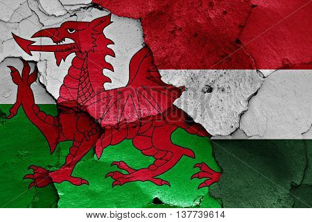 Flags Of Wales And Hungary Painted On Cracked Wall