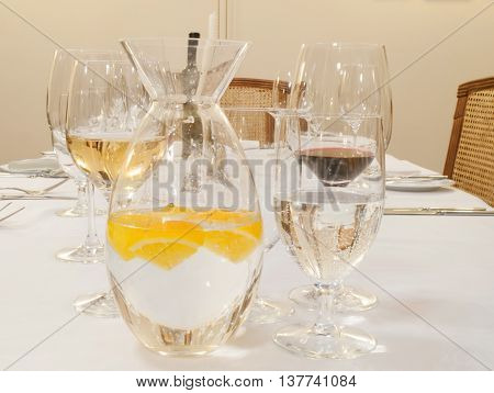 Fizzy drink from citruses with glasses set on the table
