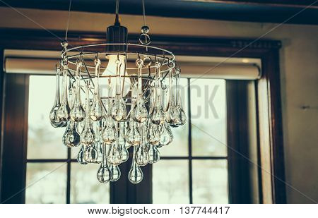 Vintage crystal chandelier ( Filtered image processed vintage effect. )