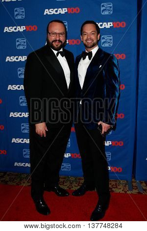 NEW YORK-NOV 17: Songwriter Desmond Child (L) and guest attend the ASCAP Centennial Awards at The Waldorf Astoria on November 17, 2014 in New York City.