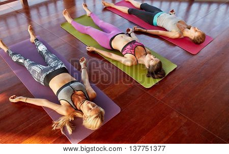 Yoga Class Lying In Savasana Pose