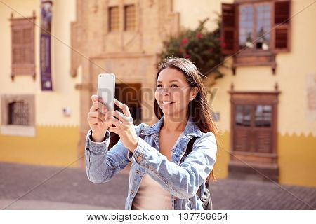 Pretty Girl Taking Pictures On Cellphone