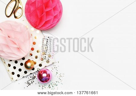 Flat lay gold stationery on white table notebook and stapler woman style desktop modern. Background mock-up. Glamour style workspace. Wedding background. Gold polka dots.