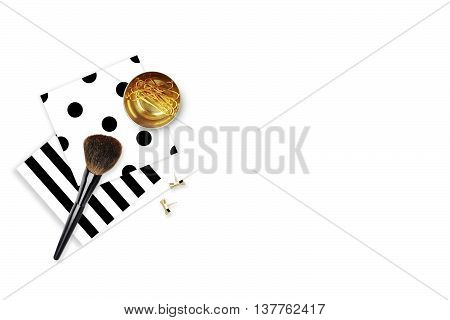 Elegant background. Black stripe pattern polka and gold clip. Flat lay. Workspace with stationery. Mock-up background. Black and White