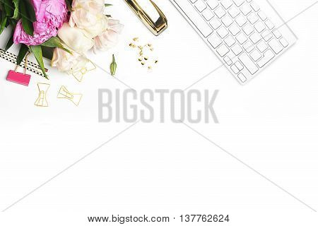 Flat lay. Flower on the table. Keyboard and stapler. Mock-up background.Peonies. Woman background.