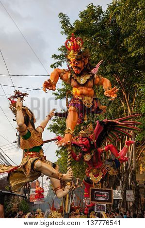 KUTA INDONESIA - MARCH 08: Ogoh-ogoh statues at the parade on the eve of Nyepi day on March 08 2016 in Kuta Bali Indonesia