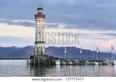Lighthouse In Harbor Of Lindau In Lake Constance