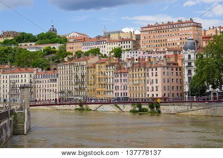 LION, FRANCE - JUNE 16, 2016:The view from river Sona to the bridge and Lyon city, France