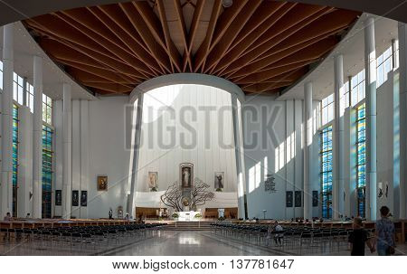 KRAKOW POLAND - JULY 8 2106: Interior of Sanctuary of Divine Mercy in Lagiewniki Krakow Poland. World Youth Day 2016 site. Resting place of Saint Faustina sacred by Pope John Paul II