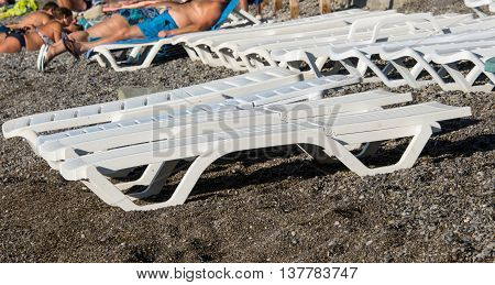 deck chairs on the pebble holiday beach