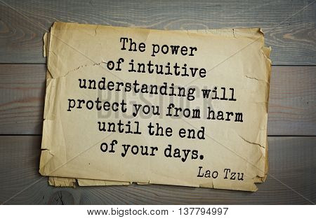 Ancient chinese philosopher Lao Tzu quote on old paper background. The power of intuitive understanding will protect you from harm until the end of your days.