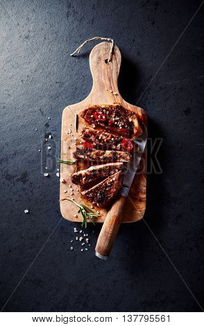 Grilled pork steaks with chili peppers and spices