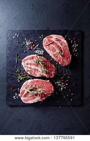 Fresh pork steaks with spices and rosemary