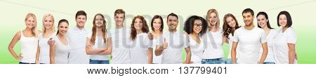 diverse, gesture and people concept - group of happy different body size and age and gender people in white t-shirts hugging showing thumbs up over green natural background