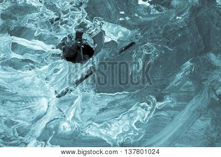 the spotty textured and indistinct abstract blue background with a hole