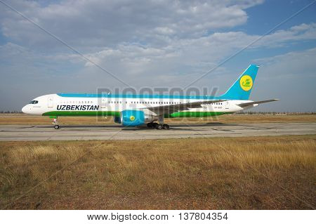Simferopol, Ukraine - September 13, 2010: Uzbekistan Airways Bowing 757-200 is taxiing along the taxiway in the airport