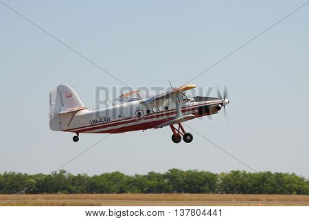 Odessa Ukraine - August 27 2011: Antonov An-3 turboprop biplane is taking off from the airfield