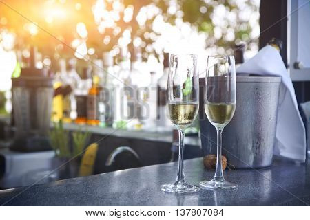 Two glasses of champagne in outdoor resort bar
