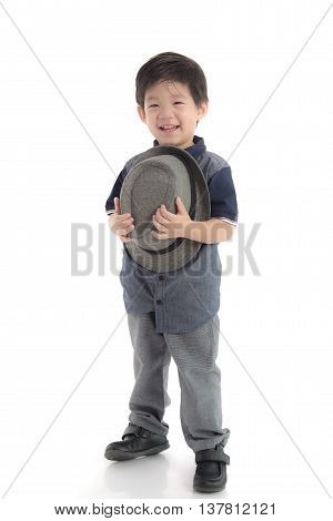 Happy asian boy holding a hat on white background isolated