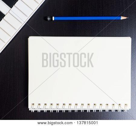 Blank Binding book with Midi Keyboard for music writing.