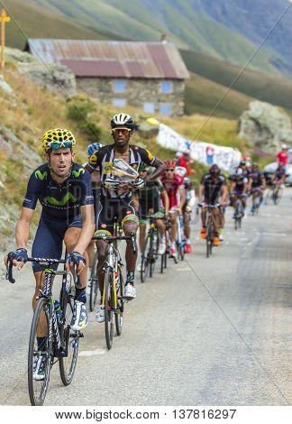 Col de la Croix de Fer France - 25 July 2015: The peloton riding in a rocky natural environment at Col de la Croix de Fer in Alps during the stage 20 of Le Tour de France 2015.