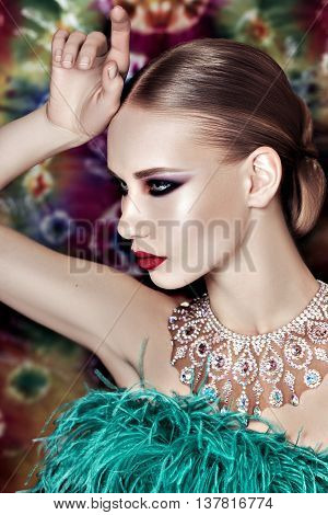 Fashion Beauty Portrait. Sexy Girl on the bright background. Holiday Makeup